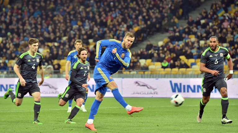 Andriy Yarmolenko shoots to score the only goal of the game