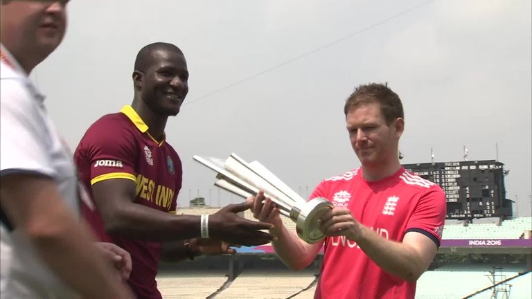 Darren Sammy is pictured with opposition skipper Eoin Morgan ahead of the final