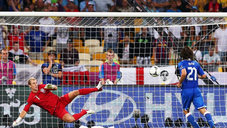 Andrea Pirlo of Italy chips the ball in the penalty shootout past Joe Hart