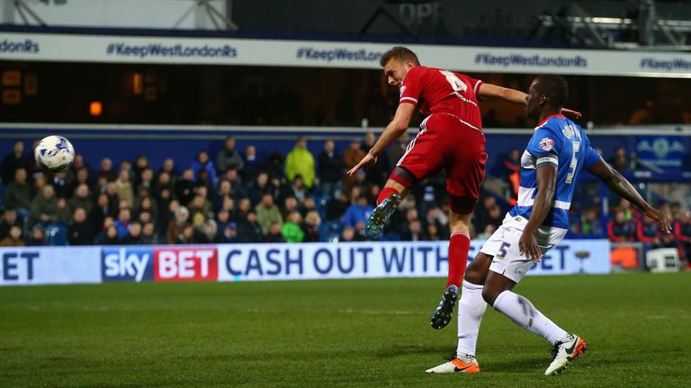 Ben Gibson of Middlesbrough heads his side's third goal
