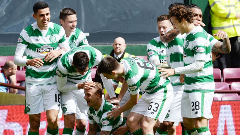 Griffiths (on floor) celebrates goal No 39 of the campaign in win over Hearts