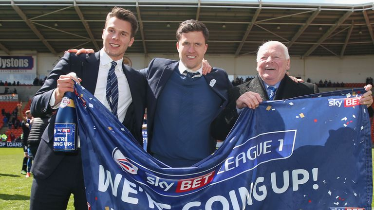 Wigan earned promotion back to the Championship under Gary Caldwell (middle)