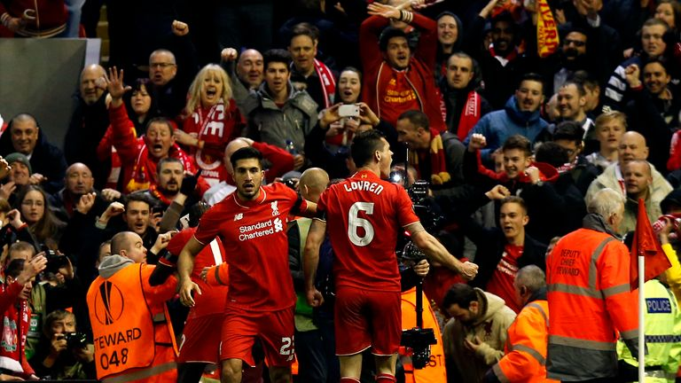 Liverpool's Dejan Lovren celebrates with Emre Can in front of the Kop