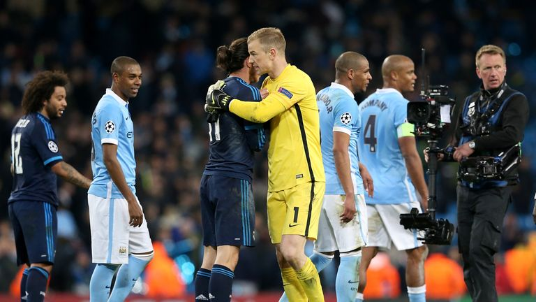 Joe Hart hugs Gareth Bale at the final whistle after keeping a clean sheet for Manchester City
