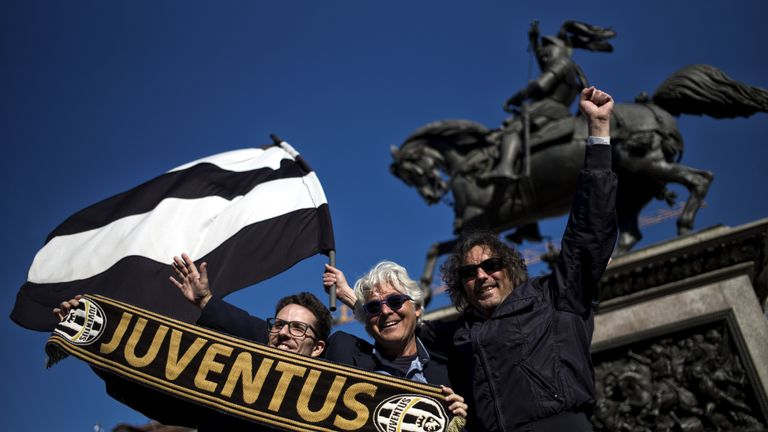 Juventus supporters celebrate in Piazza San Carlo in Turin
