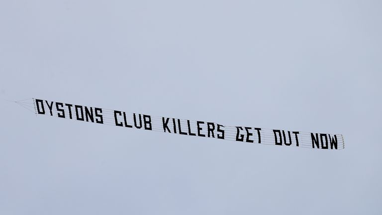 A protest banner reading 'Oystons club killers get out now' was flown over the stadium