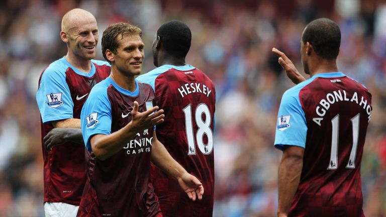 Petrov (2nd left) retired from football professional in 2013