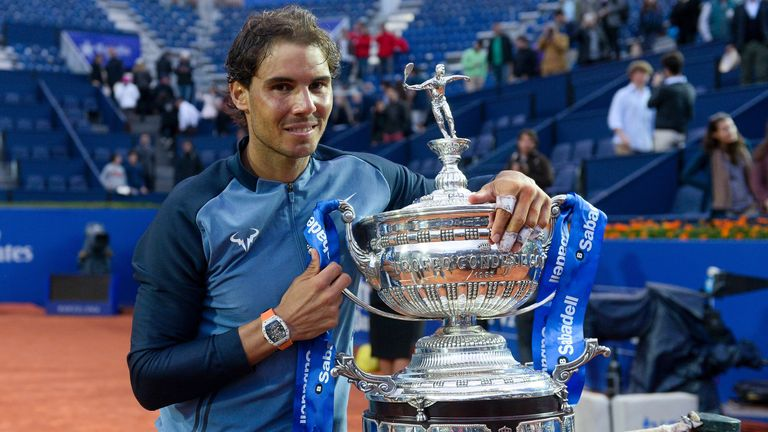 Rafael Nadal poses with his trophy after beating Kei Nishikori to win the Barcelona Open