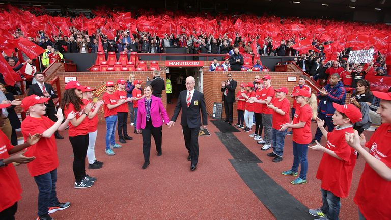Sir Bobby Charlton and his wife Norma are presented to the Old Trafford crowd before the game