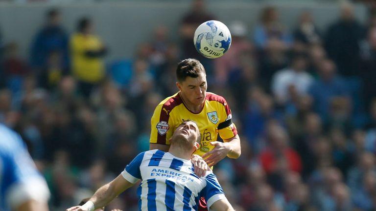Burnley's Michael Keane and Brighton's Tomer Hemed battle for the ball