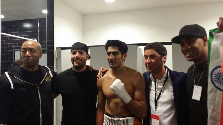 Virender Singh poses with his team after winning at the Copper Box