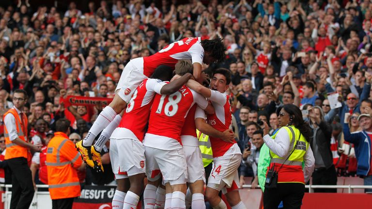 Arsenal players mob Mikel Arteta after the fourth goal