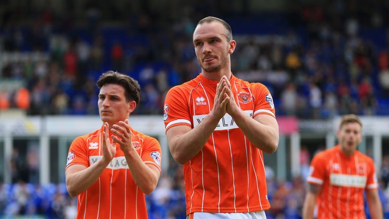 Tom Aldred and Jack Redshaw (left) of Blackpool looks dejected as they are relegated