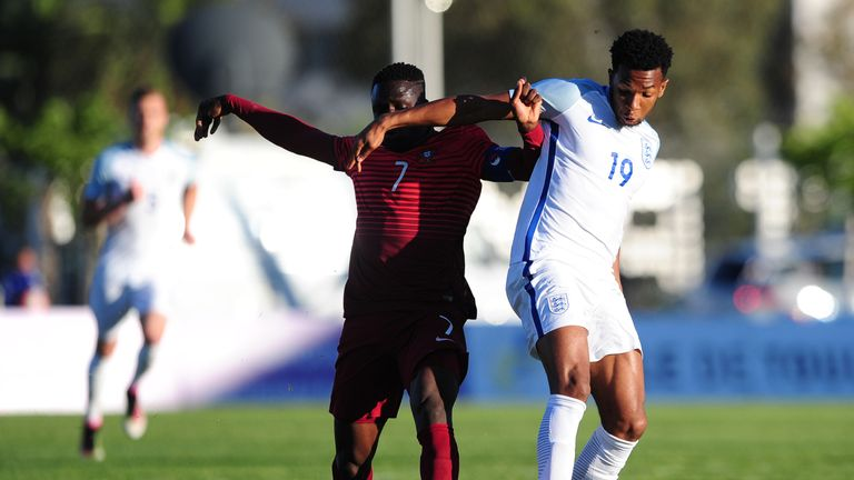 England's Kasey Palmer (right) is tackled by Romario Balde of Portugal