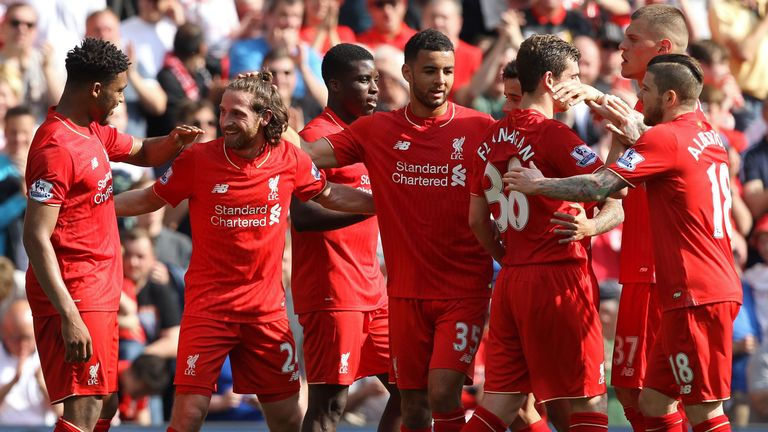 Joe Allen (second from left) is congratulated after opening the scoring