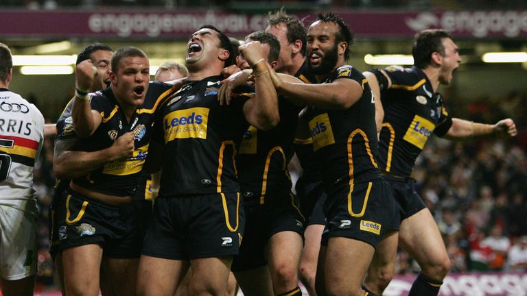 Jordan Tansey (L) of the Rhinos celebrates with teammates after scoring the match winning try in injury time