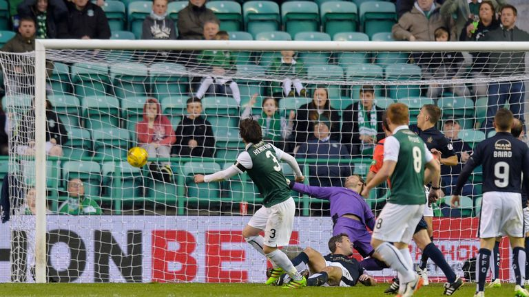 Hibernian's Liam Henderson (No 3) fires in their equaliser