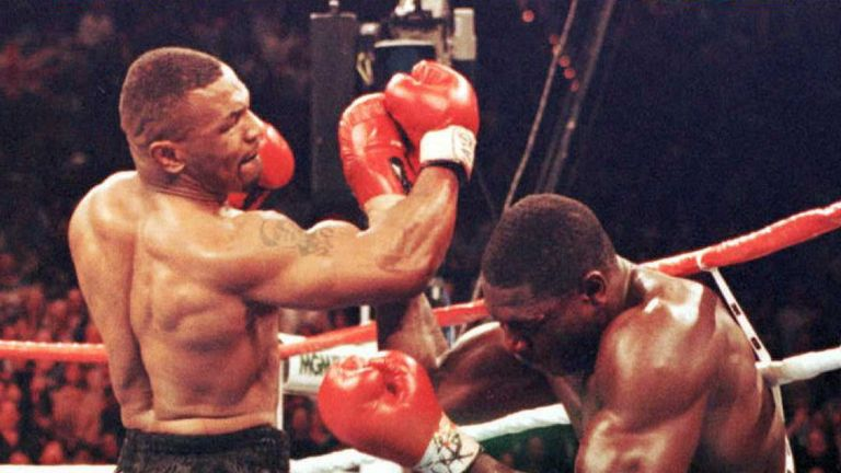 Mike Tyson (left) retired Frank Bruno with a brutal stoppage