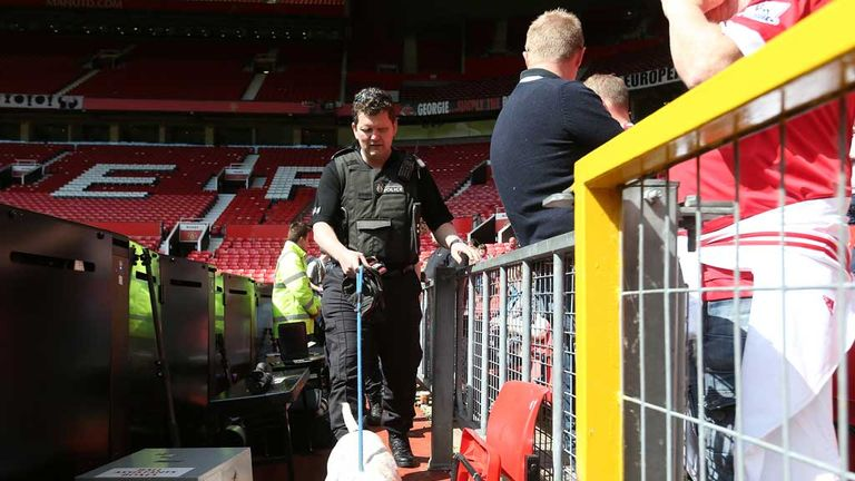 A police sniffer dog at Old Trafford after the match was called off