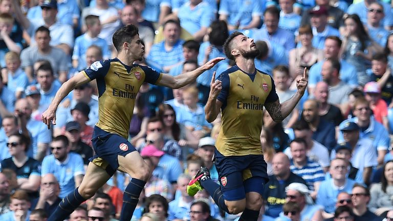 Olivier Giroud (right) celebrates after scoring at the Etihad