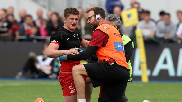 Owen Farrell receives treatment after suffering a rib injury