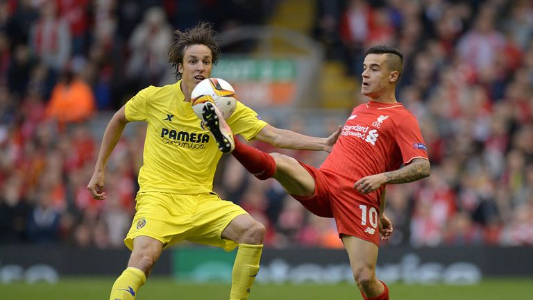 Liverpool midfielder Philippe Coutinho vies for the ball against Tomas Pina