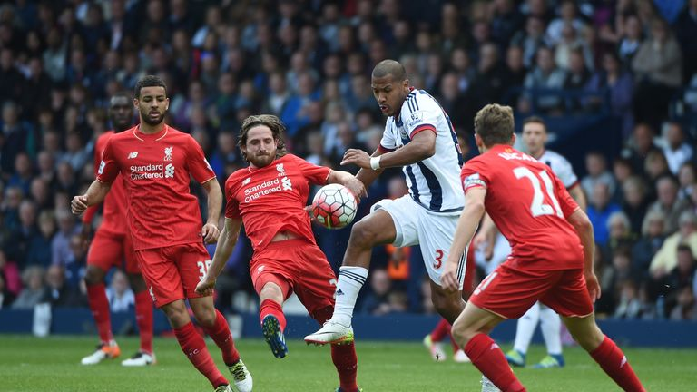 West Bromwich Albion striker Salomon Rondon controls the ball under pressure from the Liverpool defence