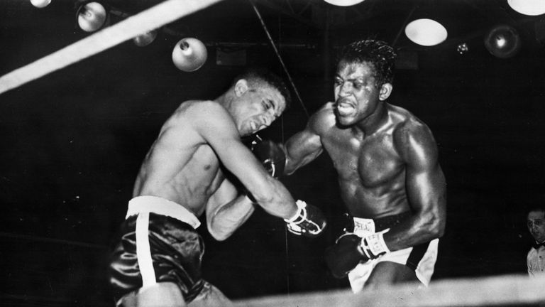 Randolph Turpin buckles under a blow from Sugar Ray Robinson
