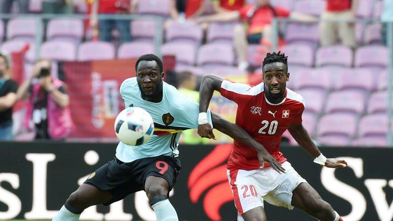 Belgium's Romelu Lukaku (L) vies with Switzerland's Johan Djourou