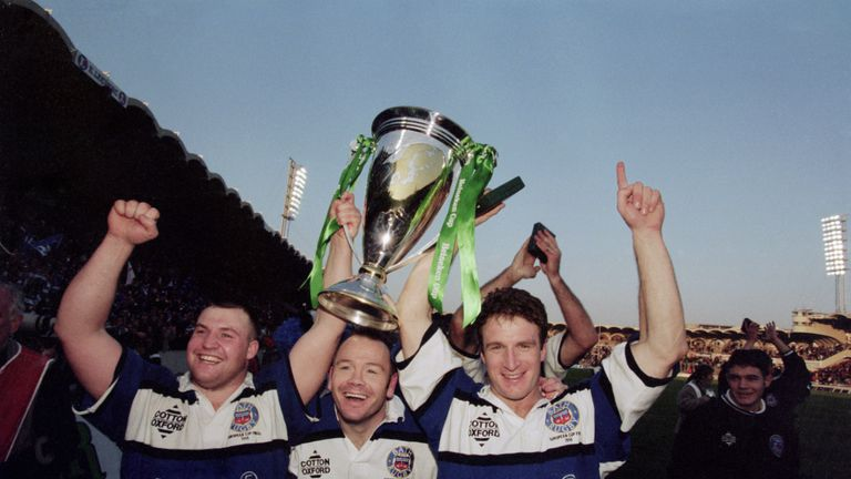 Bath rugby players Mark Regan, Ieuan Evans and Mike Catt celebrate their team's 19-18 victory over Brive in the 1998 Heineken Cup final
