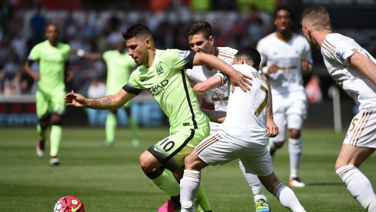 Sergio Aguero tries to find space
