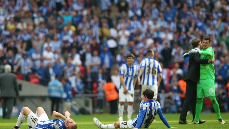 Dejected Sheffield Wednesday players are left on the Wembley pitch