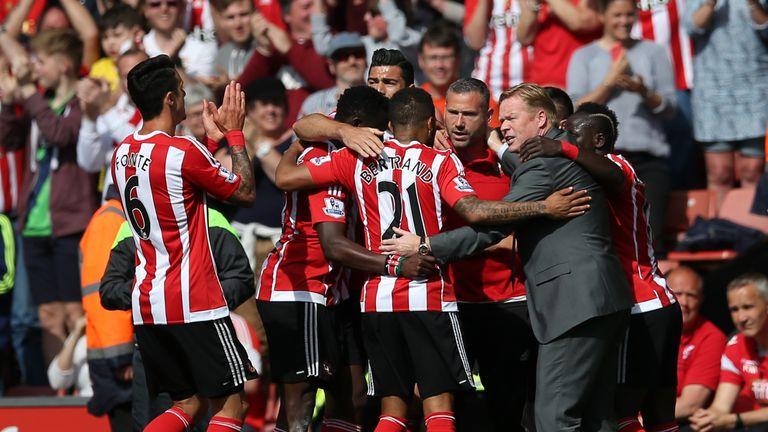 Ronald Koeman joins in the celebrations with his players
