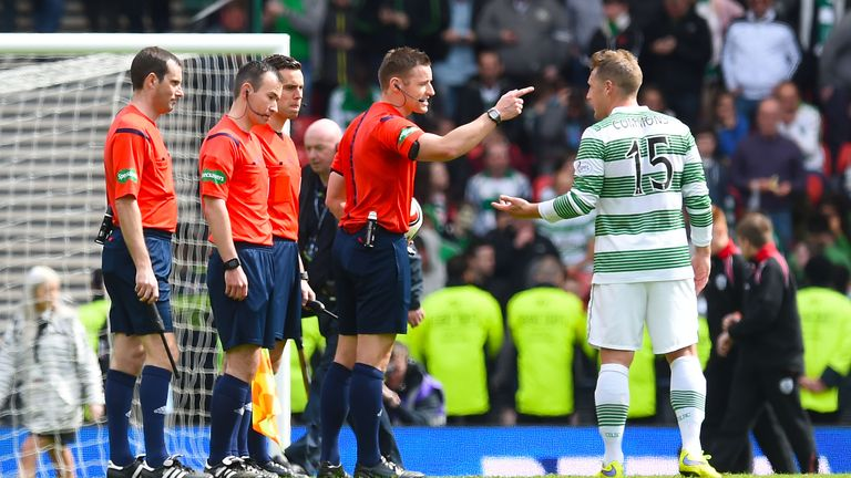 Steven McLean waves away protest from Kris Commons after failing to spot Josh Meekings' handball