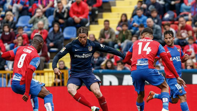 Torres battles with Carl Medjani (right) and Jefferson Lerma