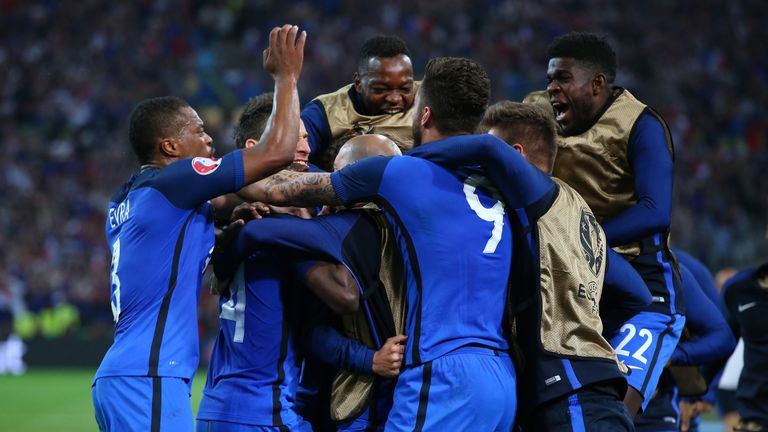 The France squad celebrate with Griezmann
