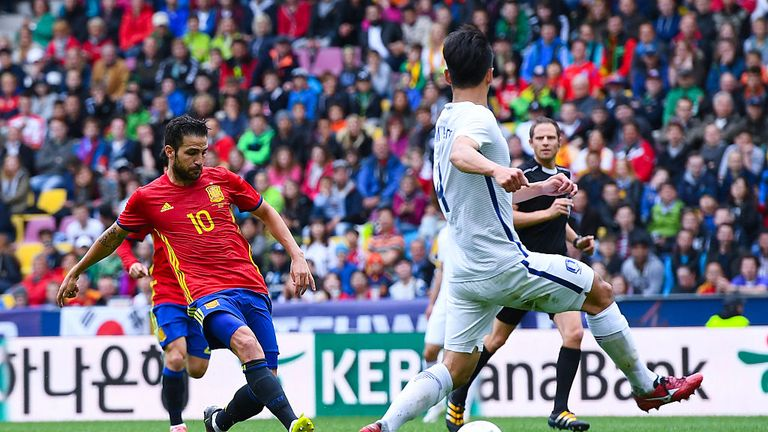 Cesc Fabregas of Spain scores his team's second goal