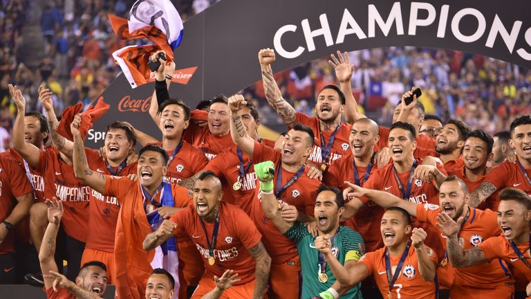 Chile's players pose with the trophy after winning the Copa America Centenario final