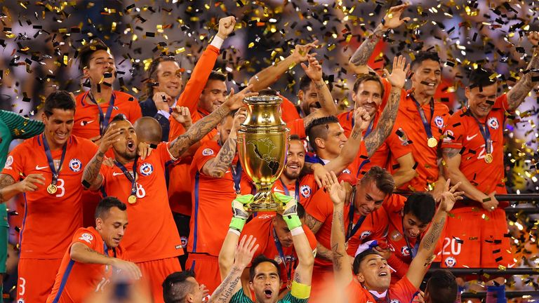 Claudio Bravo #1 of Chile lifts the trophy after defeating Argentina to win the Copa America