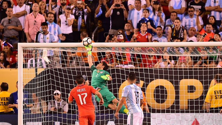 Chile's goalkeeper Claudio Bravo pulls off a save following a header by Argentina's Sergio Aguero