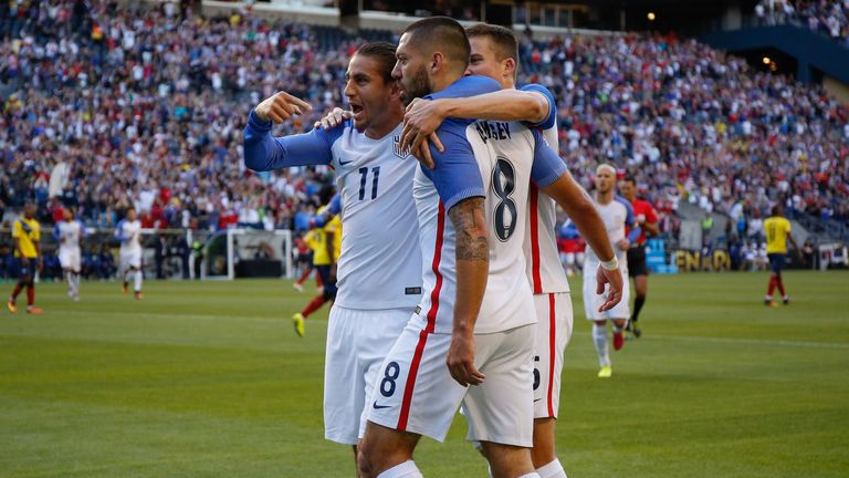 Clint Dempsey celebrates scoring for USA with his team-mates