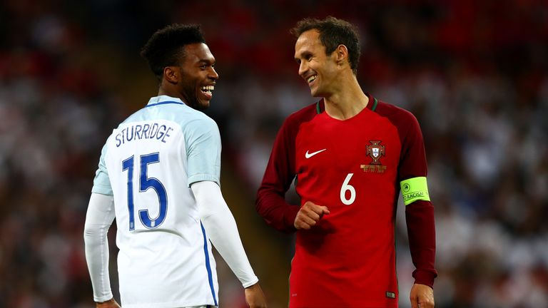 He was all smiles with Portugal's Ricardo Carvalho during the friendly at Wembley