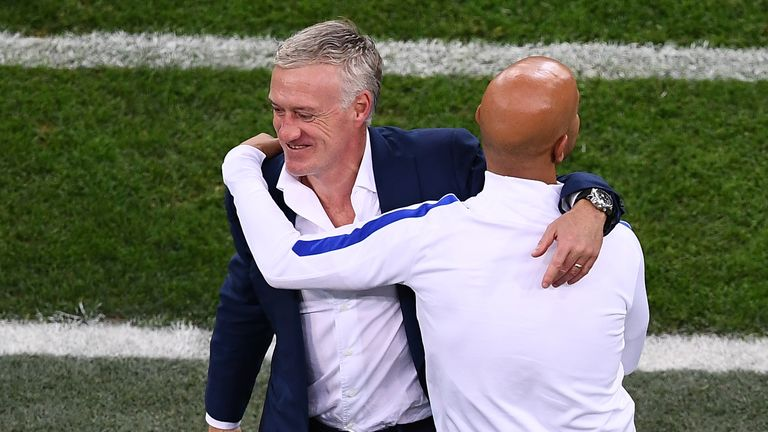 France's coach Didier Deschamps (L) celebrates victory