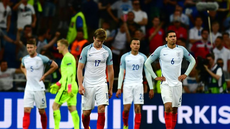 The England players look dejected after conceding late on