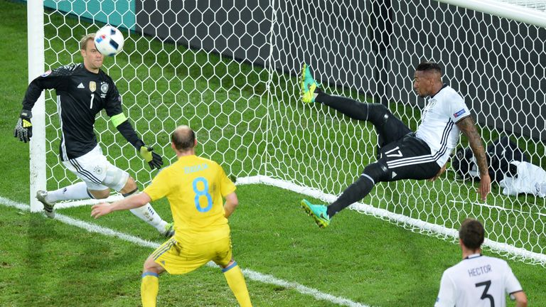 Germany's defender Jerome Boateng with an acrobatic clearance against Ukraine