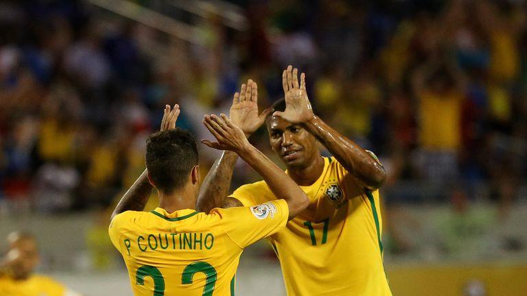 Coutinho and Walace celebrate