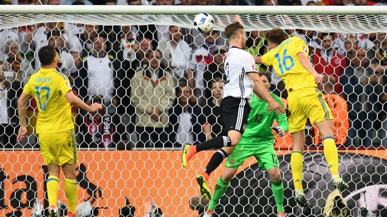 Germany defender Shkodran Mustafi (c) scores his first international goal