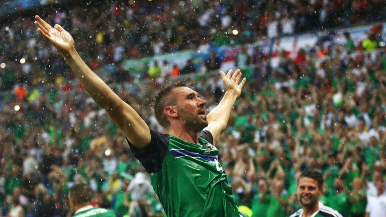 Gareth McAuley of Northern Ireland celebrates scoring Northern Ireland's opener