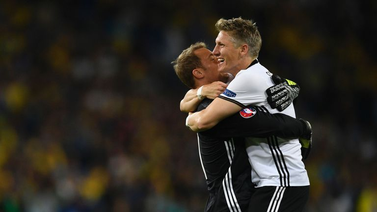 Schweinsteiger (r) and Manuel Neuer celebrate after Germany's win