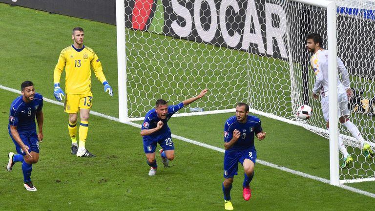 Giorgio Chiellini celebrates his opening goal against Spain